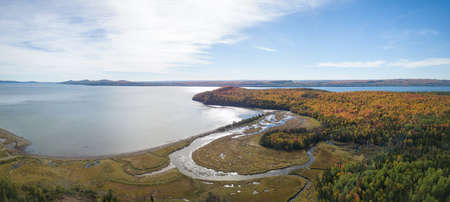 Aerial panoramic view of a beautiful Canadian Landscape during fall color season. Taken near Pointe-à-la-Croix, Quebec, Canada.