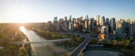 Aerial panoramic view of a beautiful modern cityscape during a vibrant sunny sunrise. Taken in Calgary Downtown, Alberta, Canada.