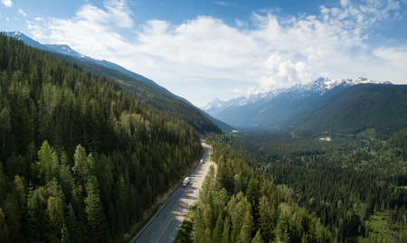 Aerial view of Trans-Canada Highway in the Canadian Mountain Landscape. Located between Golden and Revelstoke, BC, Canada. Фото со стока