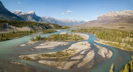 Beautiful aerial landscape view of Canadian Rockies during a vibrant sunny day. Taken in Banff, Alberta, Canada.