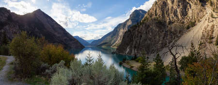 Panoramic landscape view of Seton Lake during a vibrant sunset. Taken in Lillooet, British Columbia, Canada. Reklamní fotografie