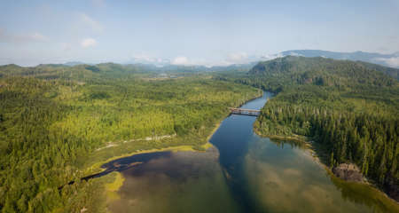 Aerial panoramic landscape view of Kennedy Lake during a cloudy summer day. Taken near Tofino and Ucluelet, Vancouver Island, BC, Canada. Banco de Imagens