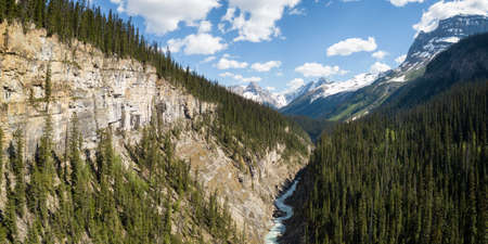 Aerial panoramic view of a beautiful canyon in the Canadian Rockies during a vibrant sunny day. Taken in Yoho National Park, BC, Canada.