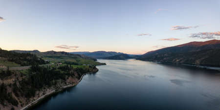 Aerial panoramic view of Kalamalka Lake during a vibrant summer sunset. Located near Kelowna and Vernon, BC, Canada.