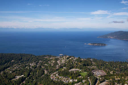 Aerial view of Residential homes by the ocean shore. Taken in Horseshoe Bay, West Vancouver, BC, Canada.