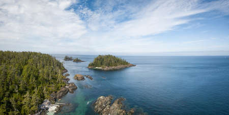 Aerial panoramic landscape of a rocky coast during a vibrant summer day. Taken on the Northern Vancouver Island, British Columbia, Canada.