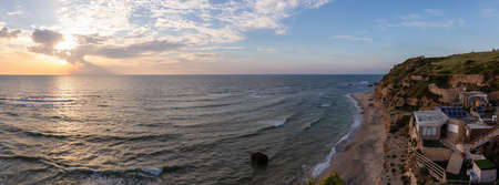 Beautiful Panoramic View on the Ocean Coast duing a vibrant sunset at the Apollonia Beach. Taken in Herzliya, Tel Aviv District, Israel.