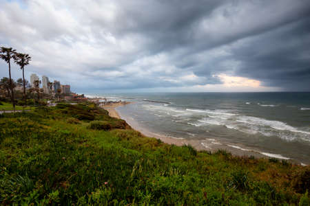 Beautiful view of a sandy beach during a cloudy sunrise. Taken in Netanya, Center District, Israel. 版權商用圖片