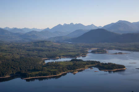 Aerial view of Lois Lake during a sunny summer day. Taken in Powell River, Sunshine Coast, BC, Canada. Stock Photo