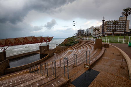 Stairs going down to the the stage at the outdoor theatre during a cloudy sunrise. Taken in Netanya, Center District, Israel.