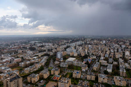 Aerial view of a residential neighborhood in a city during a cloudy sunrise. Taken in Netanya, Center District, Israel. Stock Photo