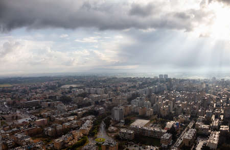 Aerial view of a residential neighborhood in a city during a cloudy sunrise. Taken in Netanya, Center District, Israel. Imagens