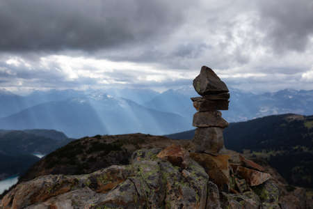 Stack of Rocks on top of a mountain during a cloudy summer day. Taken from top of Panorama Ridge, located near Whister and Squamish, North of Vancouver, BC, Canada. 스톡 콘텐츠