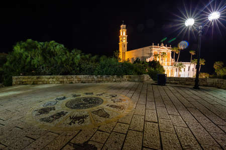 Beautiful view of Wishing Bridge in Abrasha Park with St. Peter's Church in the background during night time. Taken in Old Jaffa, Tel Aviv-Yafo, Israel. Фото со стока