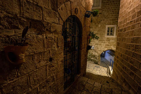 Night view in the alley ways at the Historic Old Port of Jaffa. Taken in Tel Aviv, Israel. Banco de Imagens - 127760162