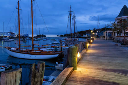 Beautiful view on the marina during a cloudy sunrise. Taken in Camden, Maine, United States.
