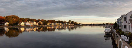 Panoramic view of residential homes by the Mystic River during a vibrant sunrise. Taken in Mystic, Stonington, Connecticut, United States. Stock Photo