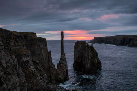 Beautiful seascape of a rocky Atlantic Ocean Coast during a cloudy sunrise. Taken in Spillars Cove, Bonavista, Newfoundland and Labrador, Canada. 版權商用圖片