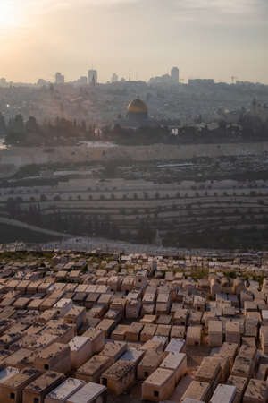 Beautiful aerial view of the Old City, Tomb of the Prophets and Dome of the Rock during a sunny and cloudy evening. Taken in Jerusalem, Capital of Israel.