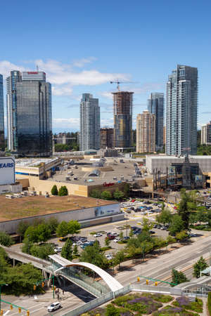 Metrotown, Burnaby, Vancouver, BC, Canada - June 26, 2018: Aerial view of Metropolis Shopping Mall during a vibrant summer day.