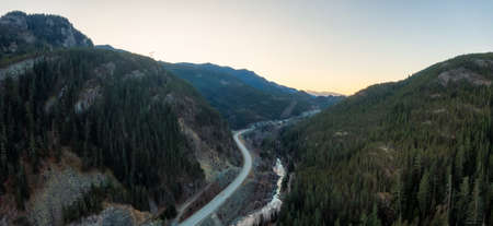 Aerial Panoramic View of the Famous Scenic Drive, Sea to Sky Highway, during a colorful sunrise. Located between Squamish and Whistler, North of Vancouver, British Columbia, Canada.