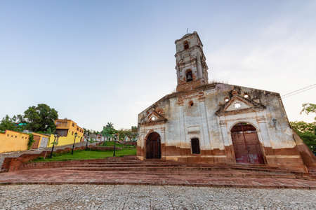 Beautiful View of a Church in a small touristic Cuban Town during a vibrant sunny and cloudy evening before sunset. Taken in Trinidad, Cuba. Archivio Fotografico