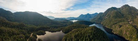 Beautiful Aerial Panoramic View of Larry Lake during a vibrant sunny day. Located on the West Coast of Vancouver Island near Tofino and Ucluelet, British Columbia, Canada.