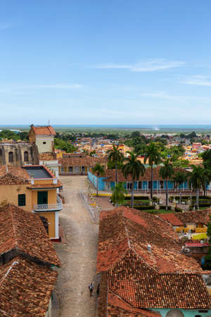 Aerial view of a small touristic Cuban Town during a sunny and cloudy summer day. Taken in Trinidad, Cuba.