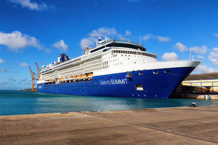 Bridgetown, Barbados - December 2, 2019: Big Luxurious Cruise Ships docked in a port during a sunny day. Editorial