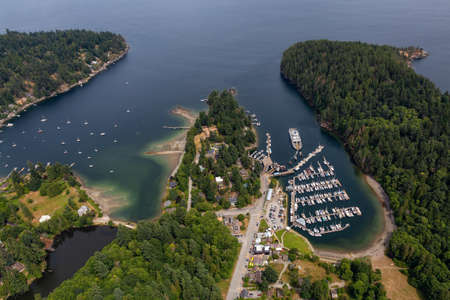 Snug Cove, Bowen Island, British Columbia, Canada. Aerial view of a marina and Ferry Terminal on the Island near Vancouver in Howe Sound.