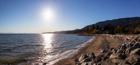 Dundarave Park, West Vancouver, British Columbia, Canada. Beautiful panoramic view of a sandy beach on Pacific Ocean Coast during a sunny summer evening.