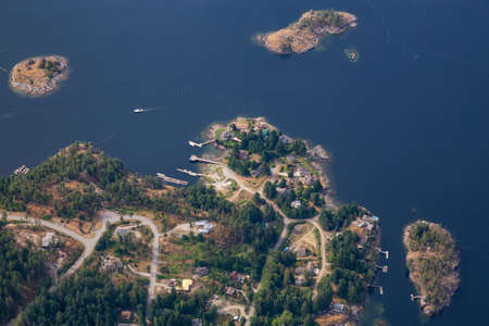Sunshine Coast, British Columbia, Canada. Aerial View of Luxury Homes at Irvines Landing during a sunny and hazy summer morning.