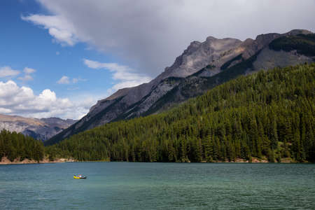 Beautiful View of Two Jack Lake during a sunny summer day. Taken in Banff National Park, Alberta, Canada.