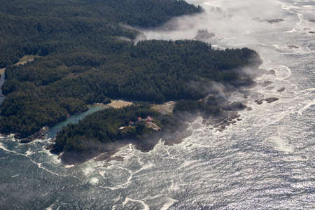 Aerial Landscape View of Beautiful Pacific Ocean Coast during a sunny summer morning. Taken at Pacific Rim National Park, South of Tofino and Ucluelet, Vancouver Island, British Columbia, Canada.
