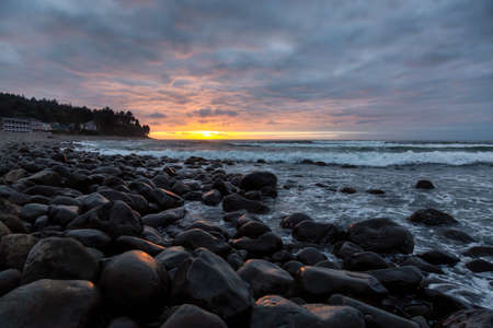 Seaside, Oregon Coast, United States of America. Beautiful View of a Rocky Beach on the Pacific Ocean during a dramatic summer sunset.