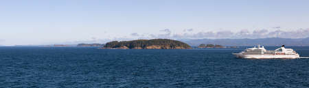 Beautiful Panoramic View of Pine Island in Duke of Edinburgh Ecological Reserve during a sunny day. Located North of Vancouver Island, British Columbia, Canada.