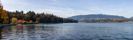 Downtown Vancouver, British Columbia, Canada. Beautiful Panoramic View of Seawall in Stanley Park during a sunny Autumn Evening.