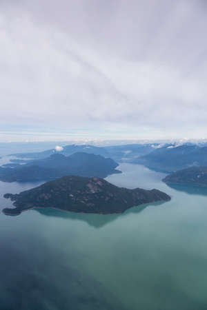 Aerial Landscape View of the Howe Sound during a cloudy summer morning. Taken North of Vancouver, British Columbia, Canada.