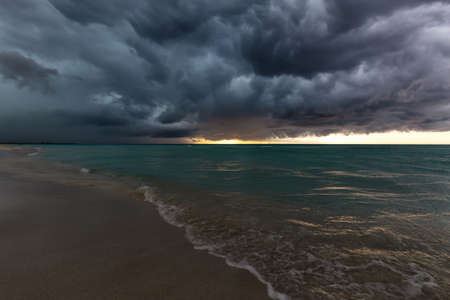 Beautiful view of a sandy beach in Varadero, Cuba, on the Caribbean Sea. Taken during a dark, thunder and lightening storm.