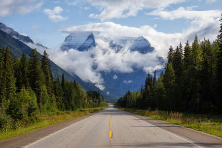 Beautiful View of Yellowhead Highway with Mount Robson in the background during a cloudy summer morning. Taken in British Columbia, Canada. 写真素材