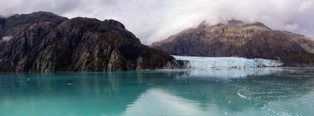 Beautiful Panoramic View of Margerie Glacier in the American Mountain Landscape on the Ocean Coast during a cloudy morning in fall season. Taken in Glacier Bay National Park and Preserve, Alaska, USA. Banque d'images