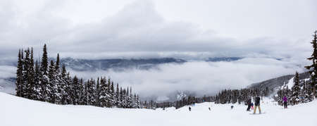 Whistler, British Columbia, Canada. Beautiful Panoramic View of the Canadian Snow Covered Mountain Landscape during a cloudy and foggy winter day.