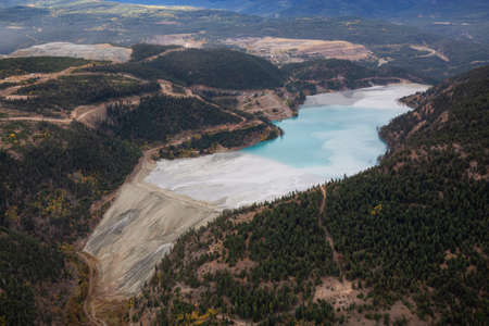 Aerial view of Copper Mine Tailing pond in the interior British Columbia, Canada. Taken during a fall season morning.