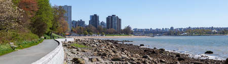 Panoramic view of English Bay in Stanley Park during a sunny day. Taken in Vancouver, British Columbia, Canada.