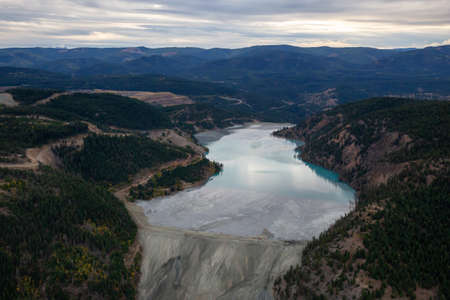 Aerial view of Copper Mine Tailing pond in the interior British Columbia, Canada. Taken during a fall season sunset. 写真素材