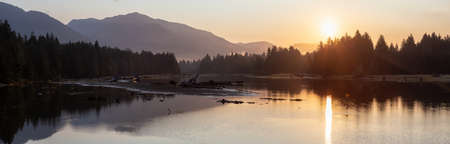Beautiful Panoramic View of Canadian Landscape during a sunny summer sunrise. Taken at Port Renfrew, Vancouver Island, BC, Canada.