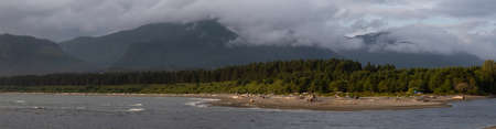 Beautiful Panoramic View of a beach in a small town during a cloudy summer sunset. Taken at Port Renfrew, Vancouver Island, BC, Canada. 스톡 콘텐츠