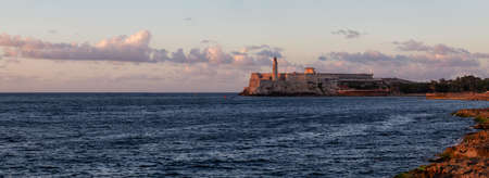 Panoramic view of the Lighthouse in the Old Havana City, Capital of Cuba, during a colorful cloudy sunset. Stock Photo