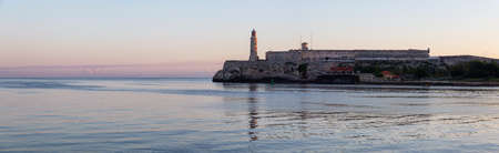 Panoramic view of the Lighthouse in the Old Havana City, Capital of Cuba, during a colorful and sunny sunrise.