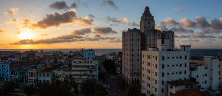 Aerial Panoramic view of the residential neighborhood in the Havana City, Capital of Cuba, during a colorful cloudy sunset.